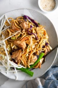 Large white plate filled with chicken and vegetable chow mein.