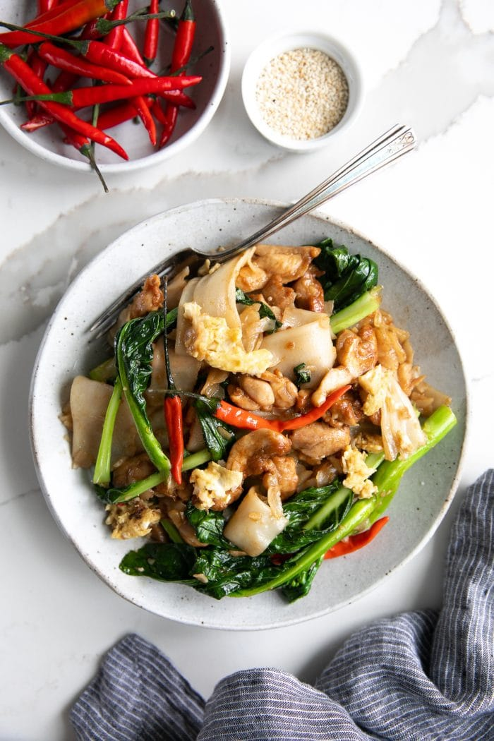 A plate of pad see ew (Phat si-io) made with chicken and chinese broccoli.
