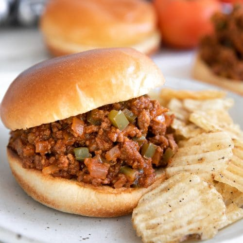 Sloppy joe sandwiched between a brioche bun with crispy potato chips.