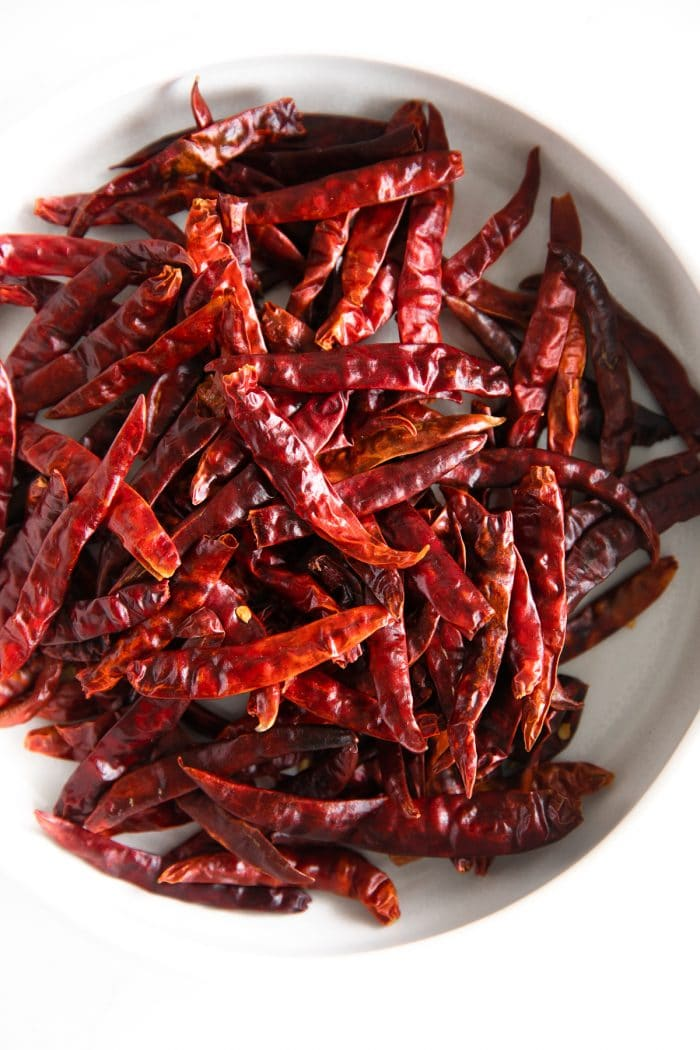 Whole dried Thai red chilis.