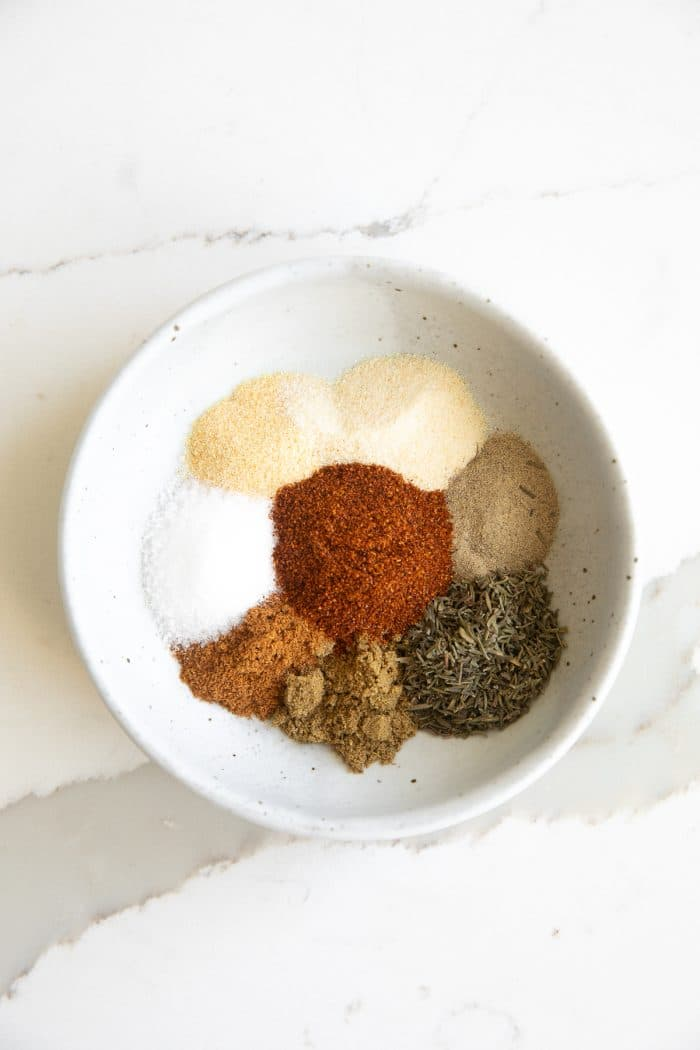 Spices for blackened chicken in a small mixing bowl.