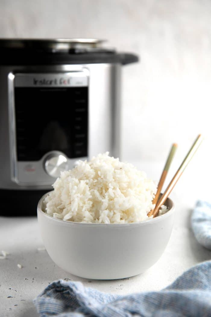 Small white bowl filled with Instant Pot cooked white rice.