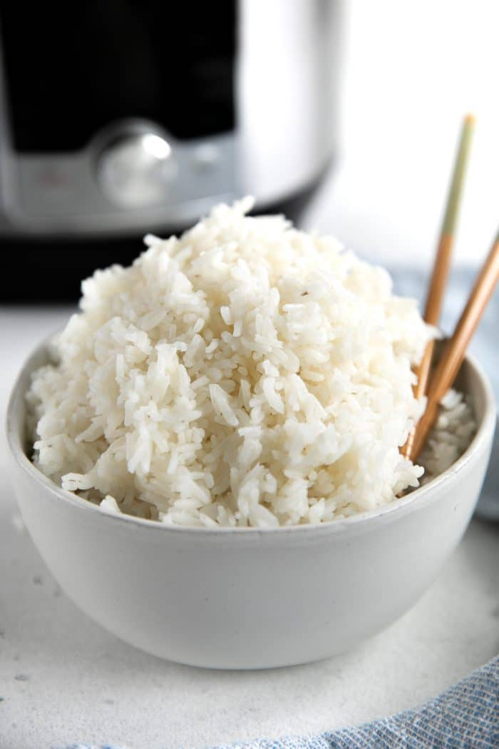 Small white bowl filled with Instant Pot cooked rice.