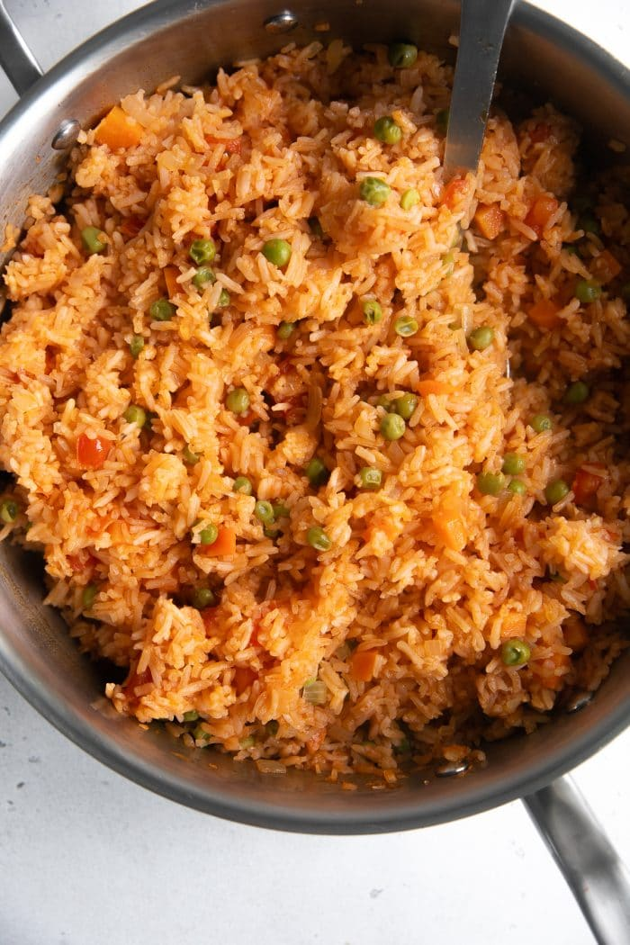 Pan filled with cooked mexican rice.