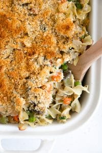 Crispy golden casserole made with canned tuna, noodles, and a homemade sauce with frozen peas and carrots.