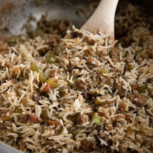 Fully cooked Cajun dirty rice recipe in a large heavy-bottomed pot ready to be served.