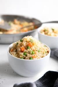 Small white bowl filled with fried rice.