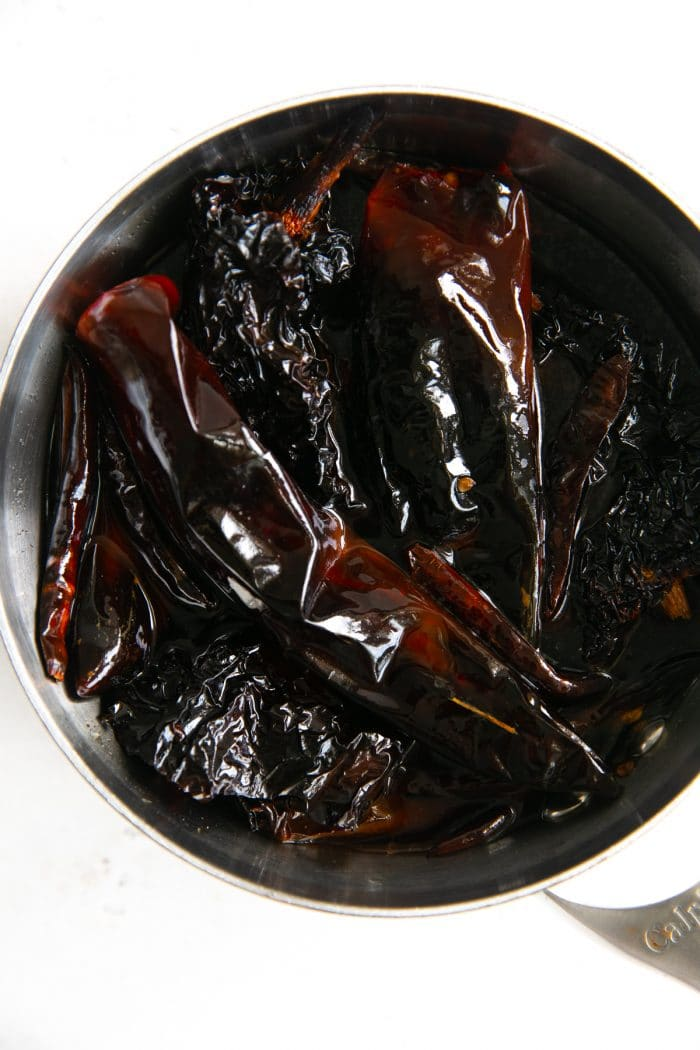 Dried chilis soaking in hot water.