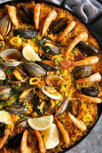 Paella filled with mussels, clams, shrimp, calamari, spanish chorizo, and saffron rice.