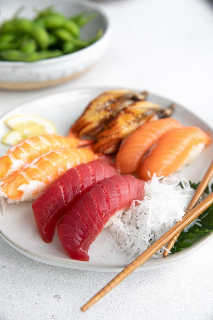 Plate filled with four different types of nigiri