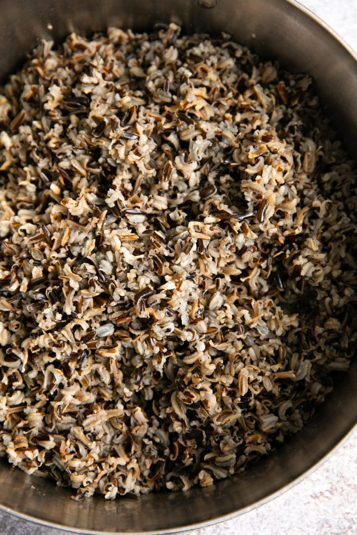 Pot filled with cooked wild rice.