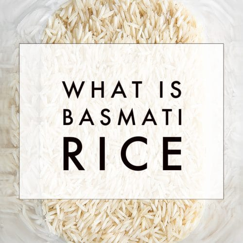 "Dry white basmati rice in a tall clear plastic storage container with text overlay ""what is basmati rice"""