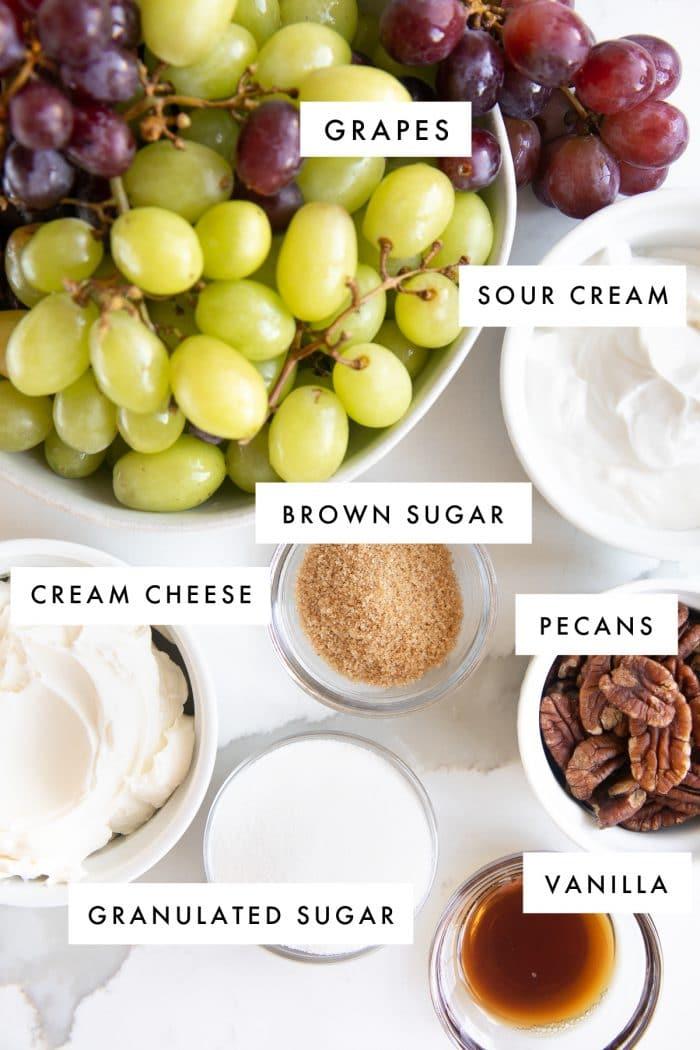 Ingredients set aside to make a creamy grape salad recipe.