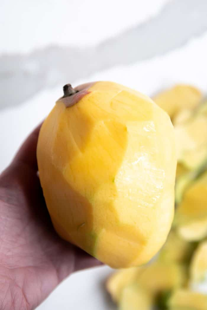 Whole mango peeled.