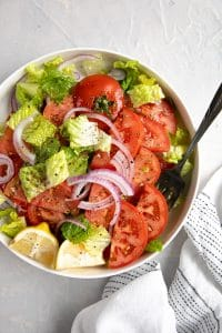 Round white platter filled with easy tomato salad recipe.