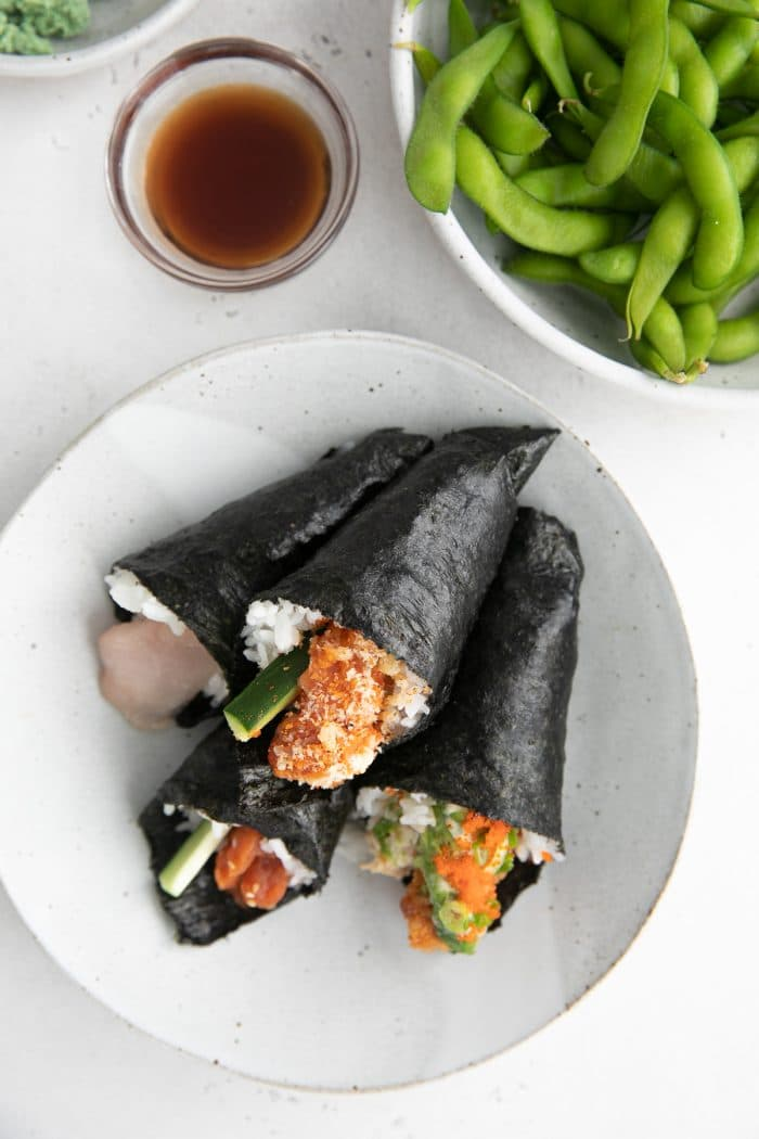 Plate filled with four hand rolls