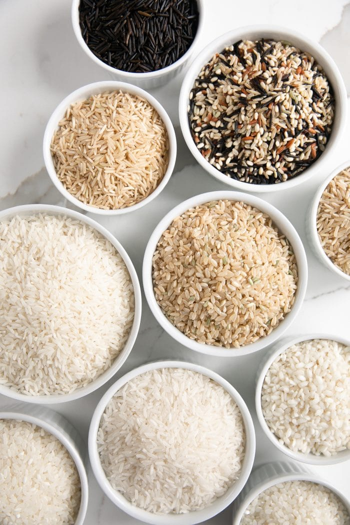 Small white bowls filled with different types of rice