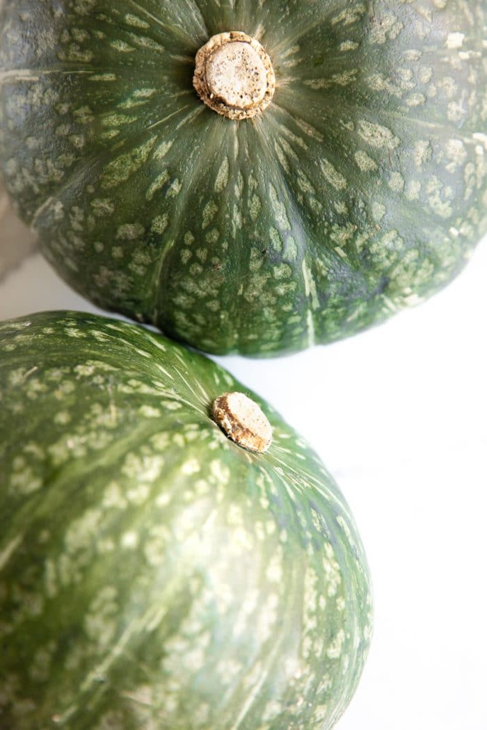 Two whole, raw, kabocha squash (Japanese squash)