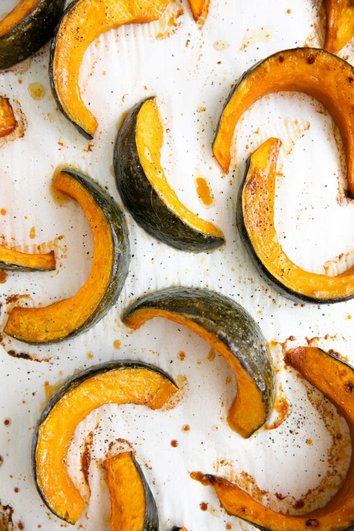 Sliced Kabocha squash on a baking sheet and roasted until tender.