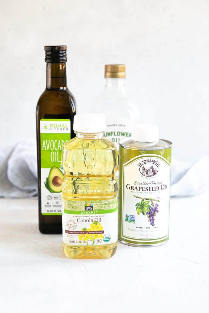 Different types of oil: canola oil, olive oil, grapeseed oil, avocado oil.