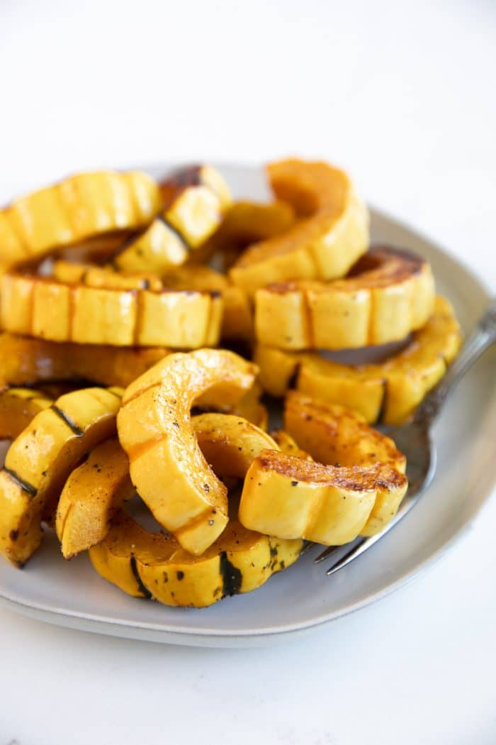 Cooked delicata squash cut into half-moons and roasted until golden brown.