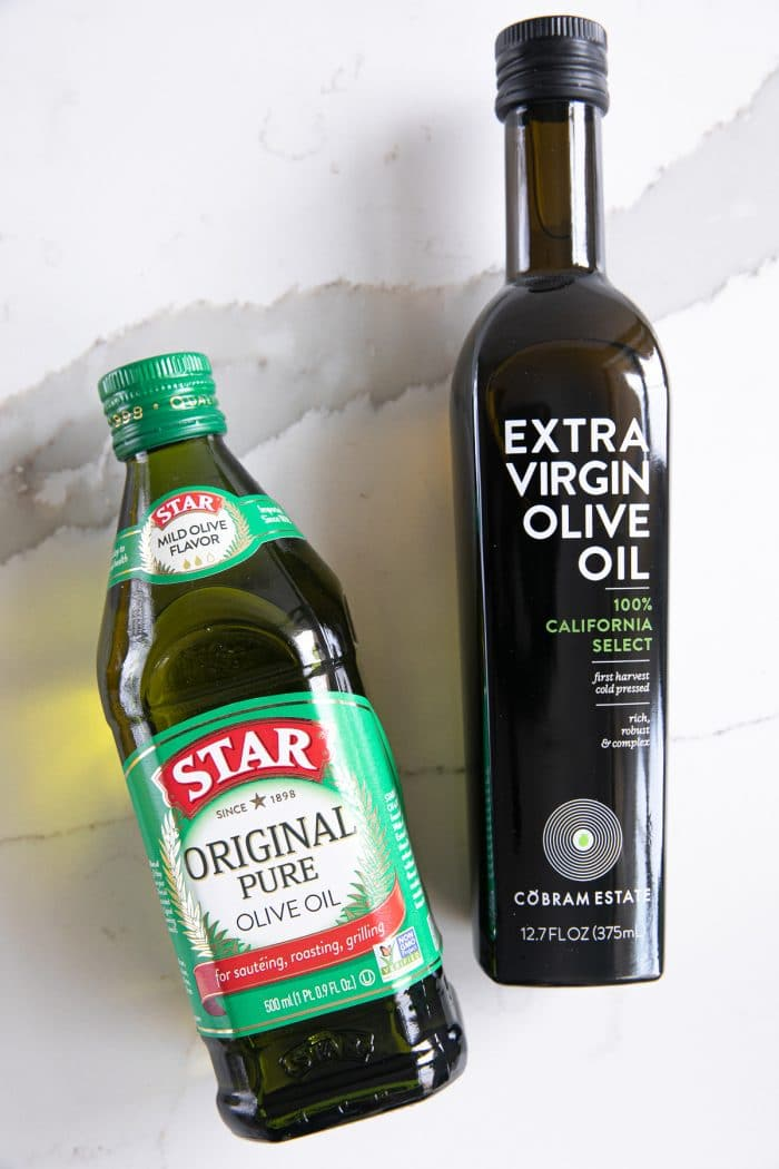 One bottle of Star brand olive oil and Cobram Estates Extra Virgin Olive Oil