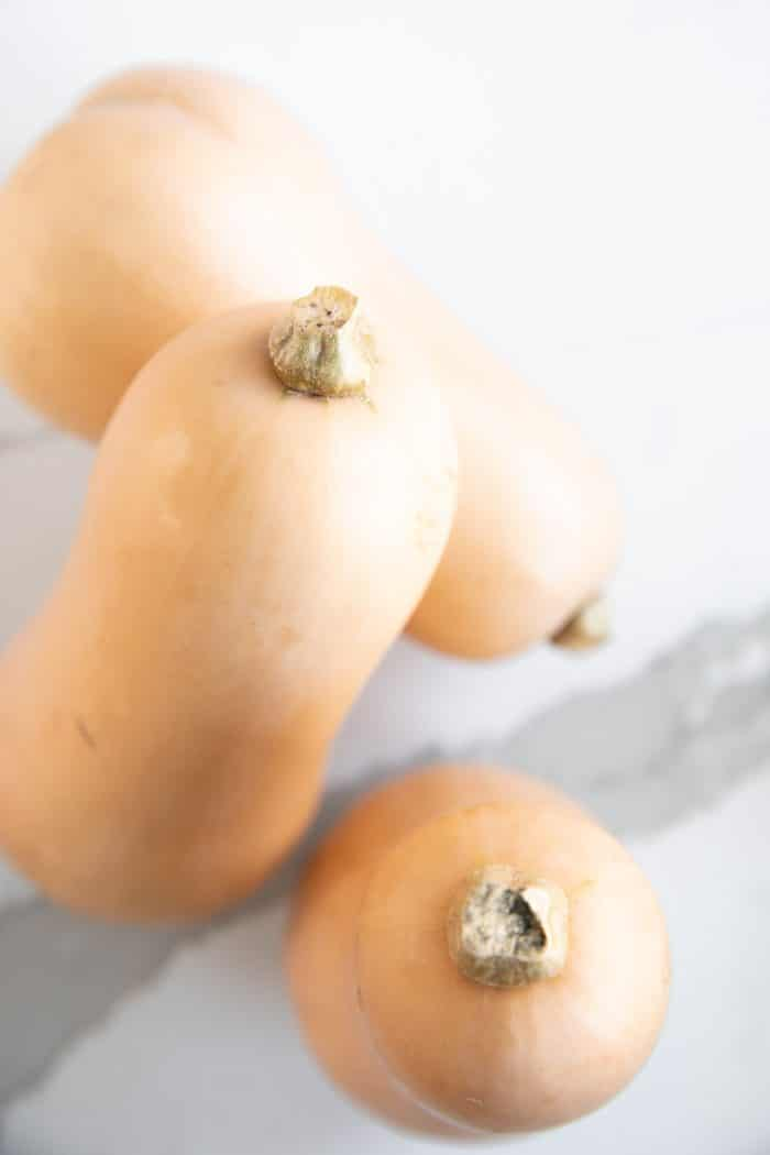 Three whole large butternut squash