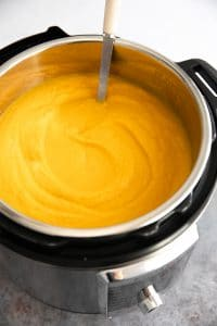Instant Pot filled with creamy blended butternut squash soup