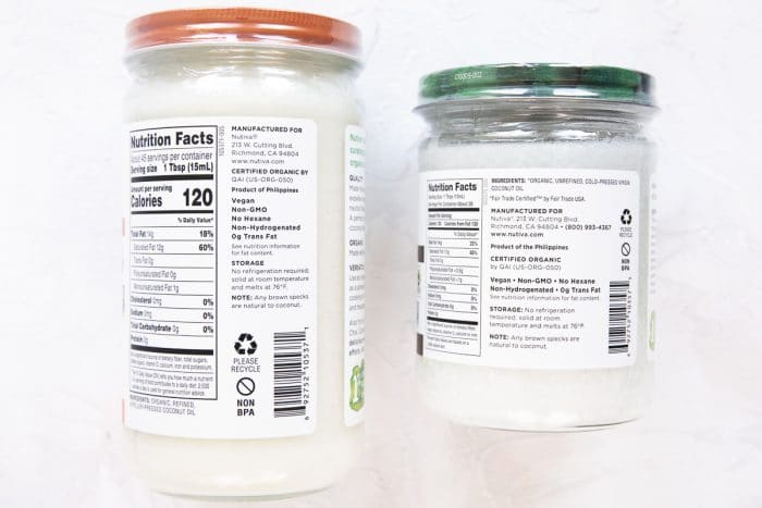 The back label of two jars of coconut oil, one which is refined and one which is not.