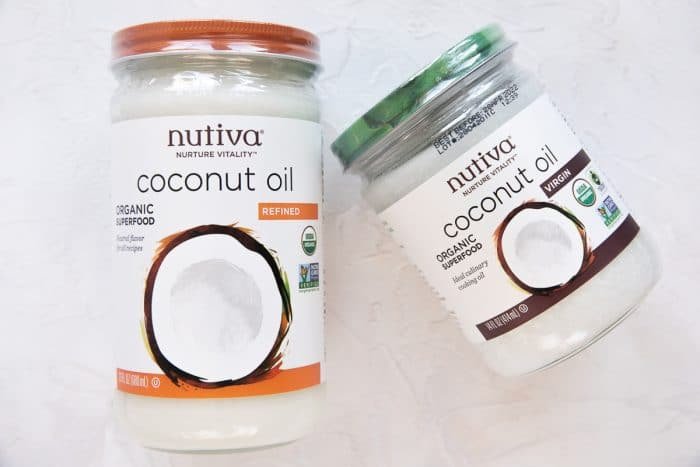 Two jars of Nutiva coconut oil, one that is refined, and one that is not refined.