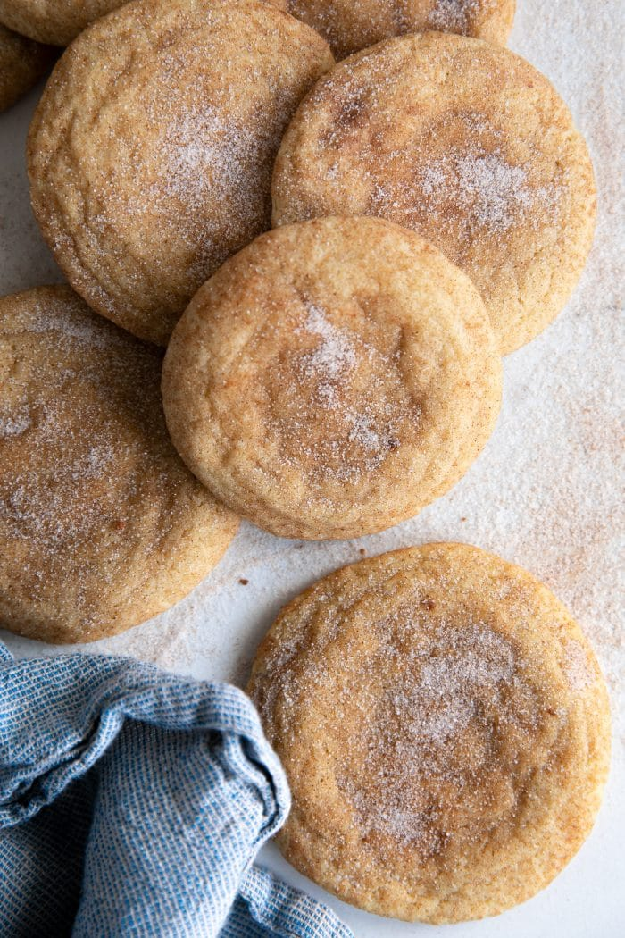 Baked snickerdoodle cookies sprinkled with extra sugar and cinnamon.