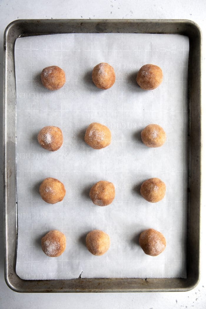 Baking sheet with 12 ball of cookie dough