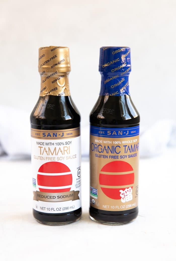 Two bottles of unopened tamari - one that is organic and one that is low-sodium.