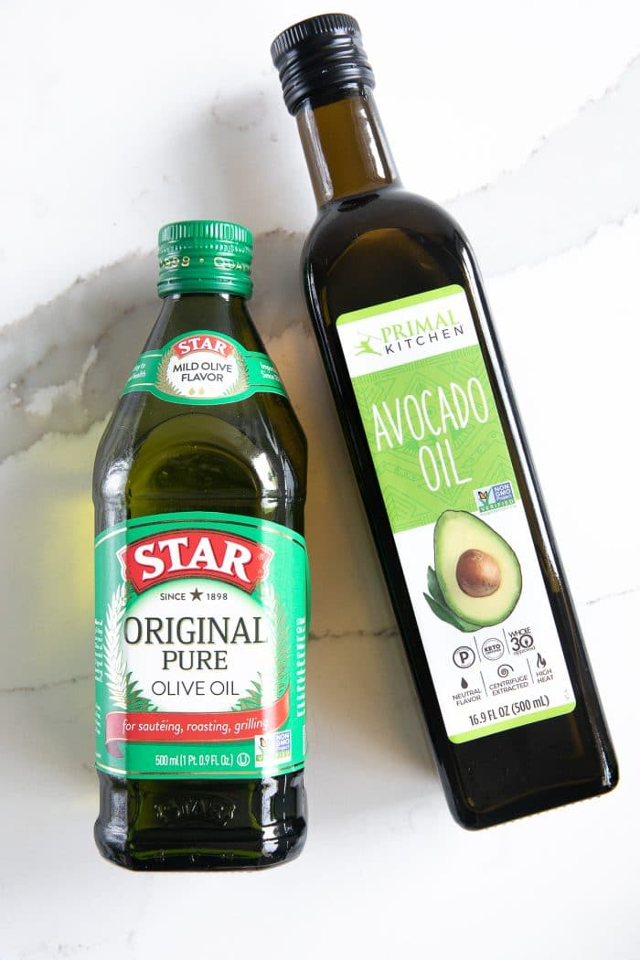 One bottle of olive oil and one bottle of avocado oil.