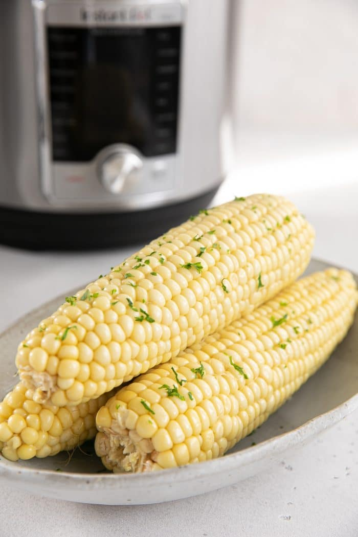 Buttery cooked corn on the cob cooked in the Instant Pot