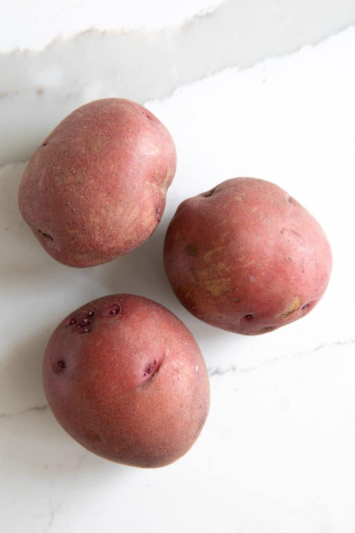Three red potatoes.