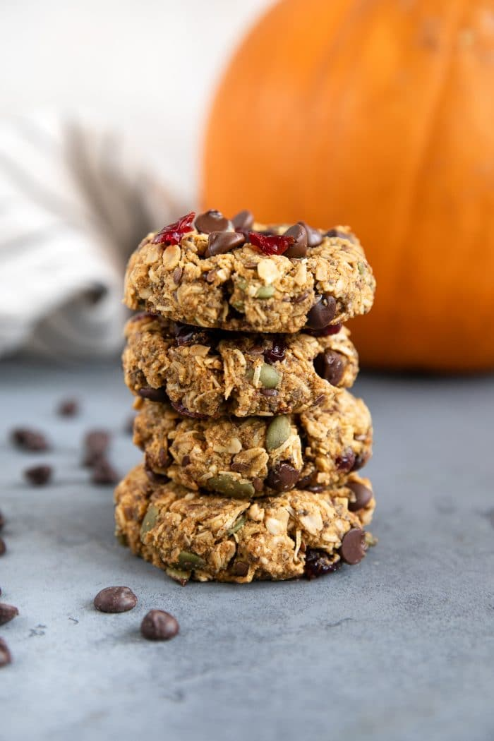 Four autumn granola breakfast cookies stacked on top of each other.