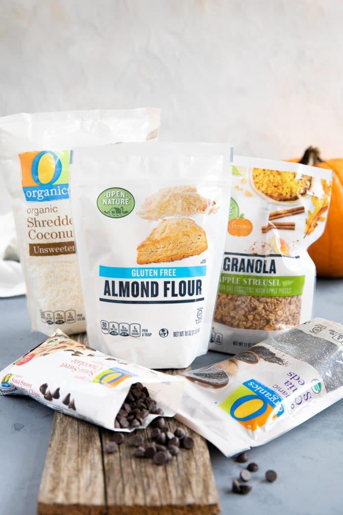 Bag of apple spiced granola, O organics chia seeds, Almond flour, shredded coconut, and chocolate chips.