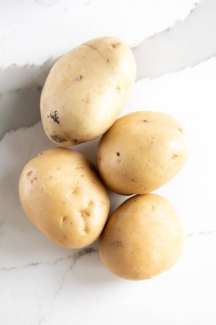 Four Yukon gold potatoes.