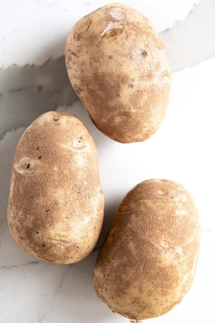 Three russet potatoes.