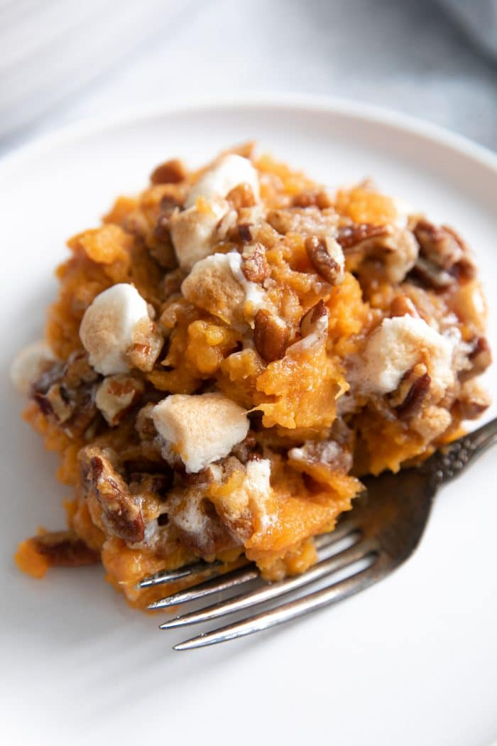 Serving of sweet potato casserole recipe on a small white plate.