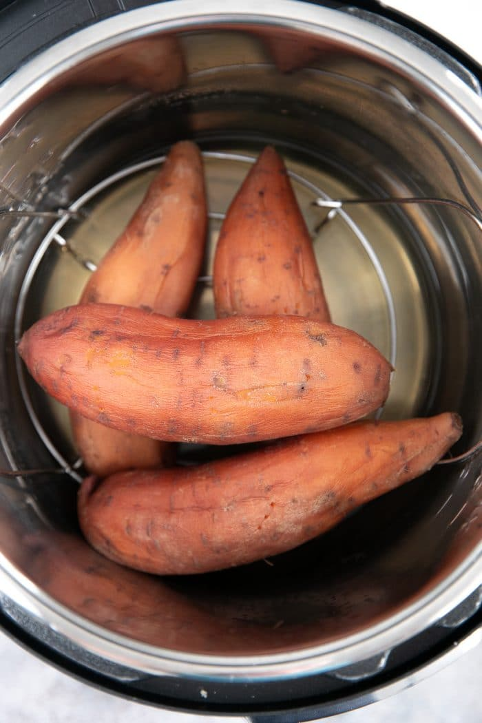 Four sweet potatoes in an Instant Pot after cooking.