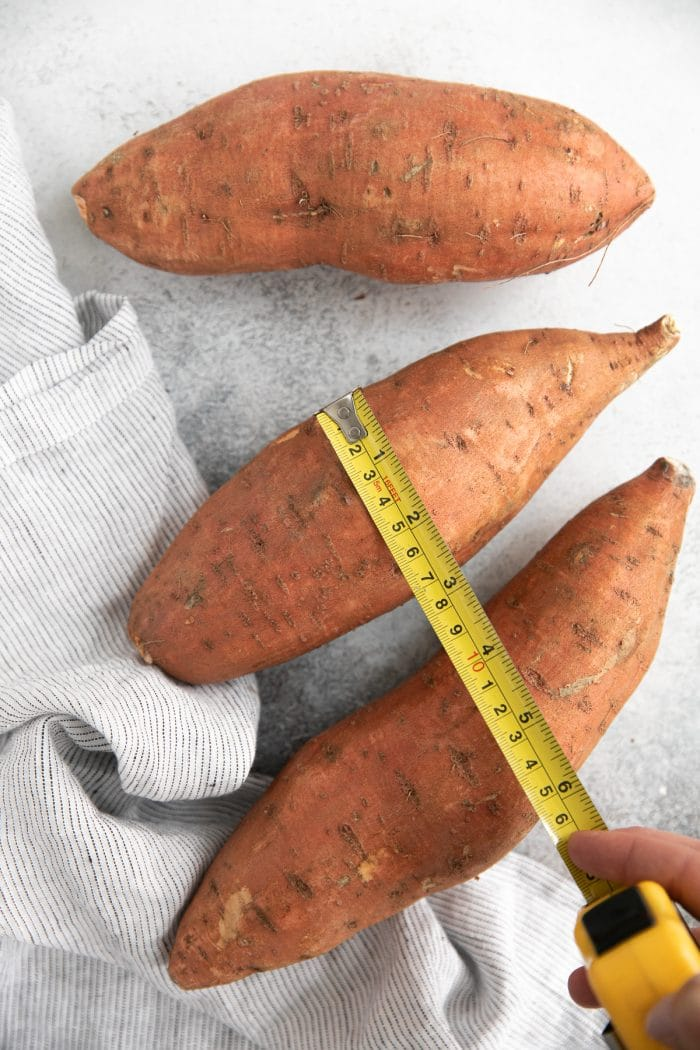 Measuring the width of a sweet potato.