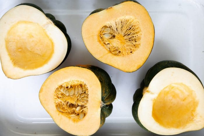 Image of two acorn squash that have been cut in half.