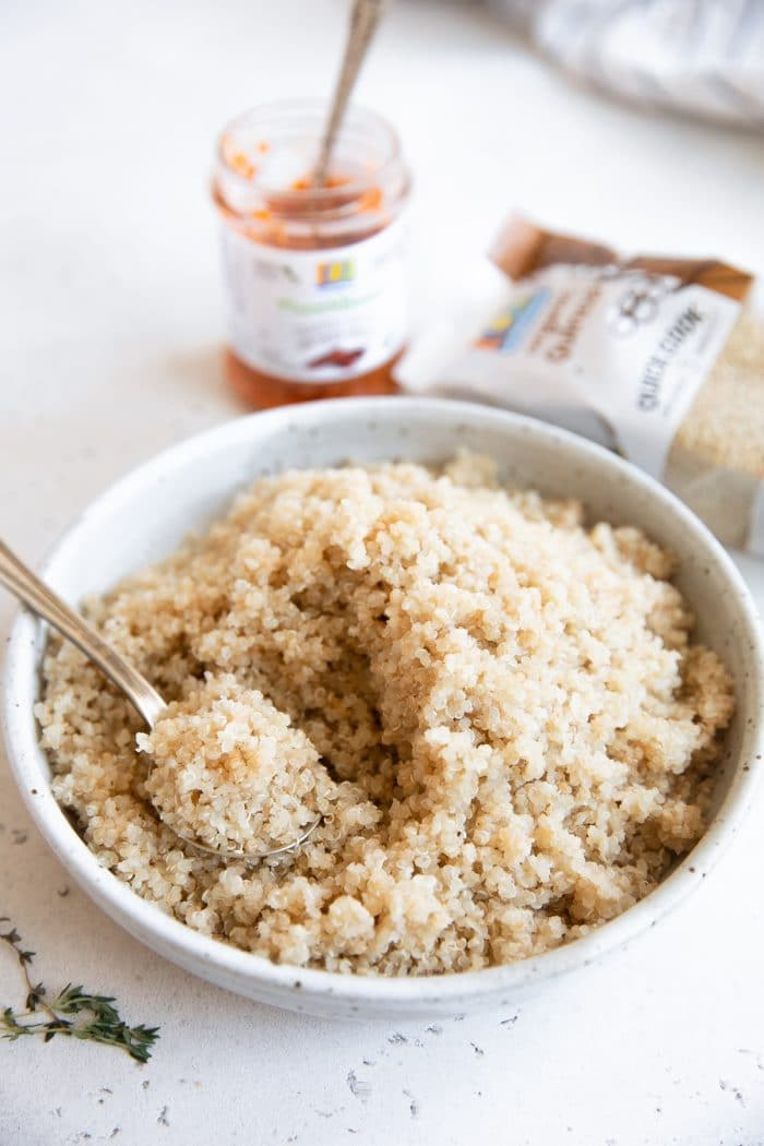 Bowl filled with cooked quinoa.