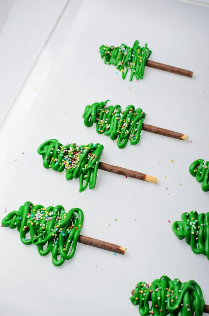 Making individual chocolate Christmas tree toppers.