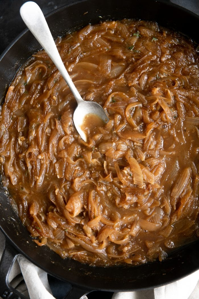 Caramelized onions and broth in a large skillet.