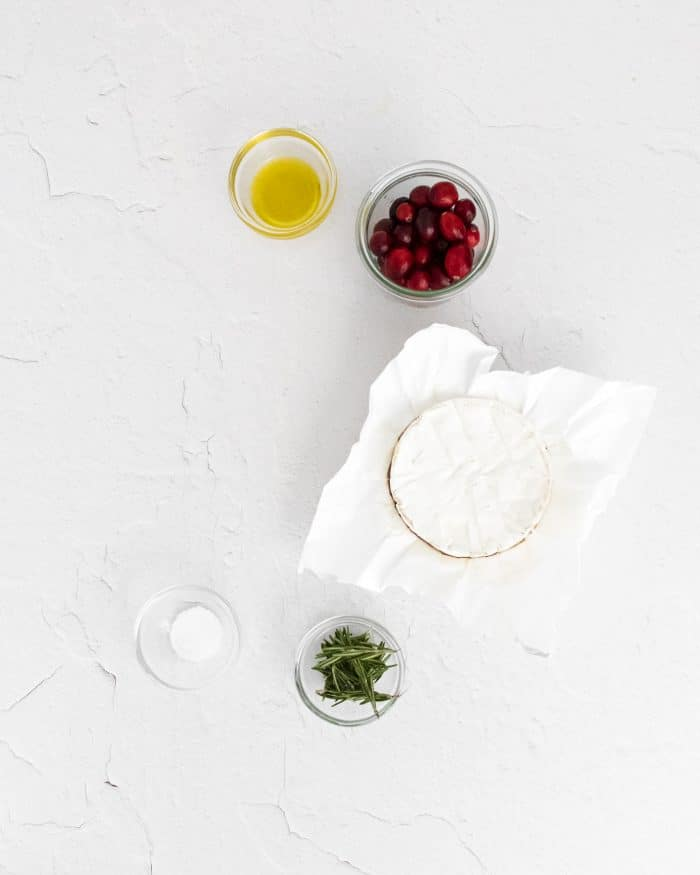 Five ingredients needed to make baked brie with roasted cranberries