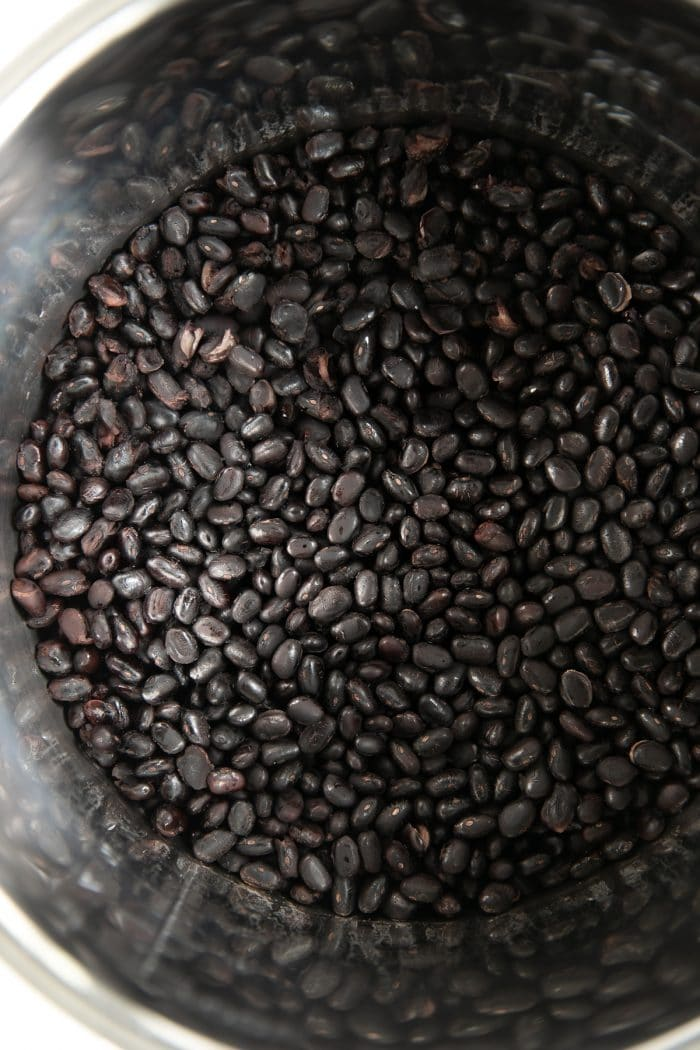 Image of an Instant Pot filled with perfectly cooked black beans.