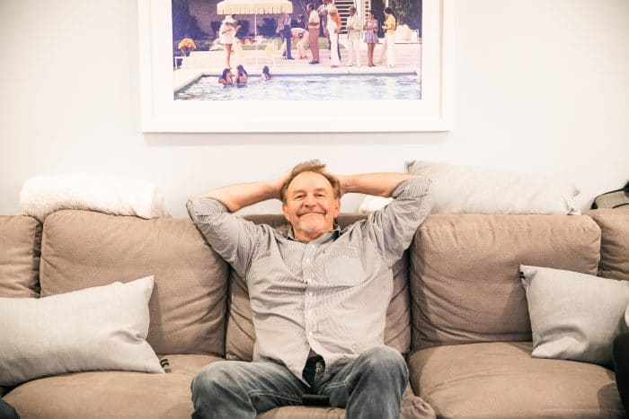 picture of my dad sitting on a couch.